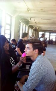 Celebrity Makeup Artist Brandy Gomez-Duplessis in New York prepping male model with a Beauty Blender