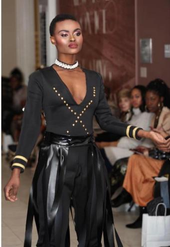 Model Voss walking runway at Harlem Fashion Week makeup by Brandy Gomez-Duplessis